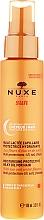 Leche-aceite protector solar para cabello y cuero cabelludo con aceite de coco, resistente al agua - Nuxe Sun Milky After Sun Hair Oil — imagen N1